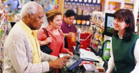 photo of elderly man in grocery store