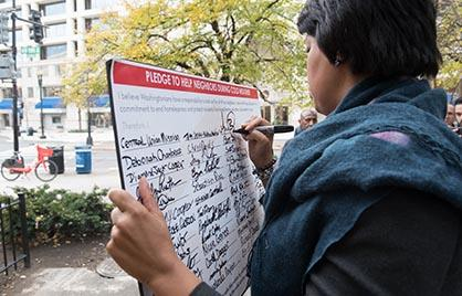 Mayor Bowser signs the hypothermia pledge